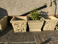 Two ornate concrete planters