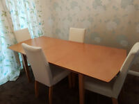Extendable dining table and 6 chairs for sale. Seats 4 or 6 depending on your requirements