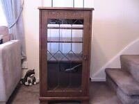 Oak music cabinet with glass door