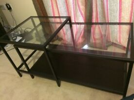 Black framed glass topped coffee and side table set.