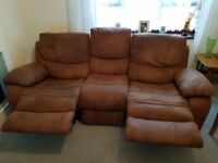 Faux Leather 3 Seater double recliner. In Brown. In very good condition.