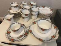 Vintage 38 piece tea set including cups and saucers / sugar bowl / side plates and cake platter