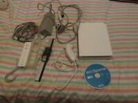 WII CONSOLE BUNDLE,ALL LEADS,SENSOR BAR,WII REMOTE,NUNCHUCK AND WII SPORTS .