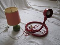Two small desk lamps – green ceramic bed lamp with pink shade and a red reading lamp with flexible .