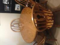 Solid oak dining room table with leaf and 4 chairs