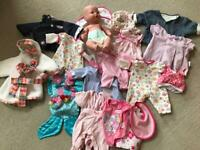 Baby doll and selection of clothes