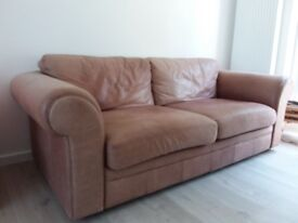 A pair of 2-seater, light brown, leather sofas - used & well-loved.