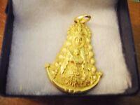 "18 carat gold large pendant of ""The Madonns de el Rocio"""