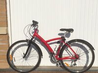 Barely used woman's red Hybrid b-twin bike