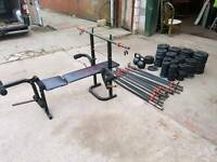 Weiider weight bench, weights (Plastic) and bars + 2 kettlebells