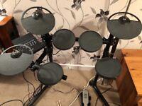 DTX 400 ace little electric drum kit.