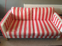 Ikea karlstad sofa with red and white stripes