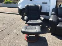 Black leather swivel armchair and puffee £75