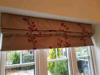 Roman blind. dark gold colour with Red embroidered leaf pattern