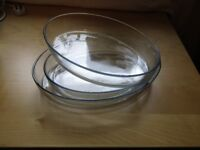 Three large oval pyrex serving/cooking dishes