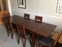 Dining table with six chairs. Dark wood, sturdy and in excellent condition.