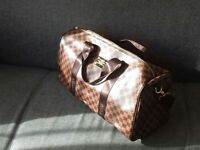 Louis Vuitton Brown Holdall and weekend bag with shoulder strap