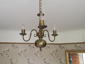 Three armed pendant light in antique brass with chain fitting