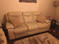 2 piece leather suite in cream with recline. 2years old like new