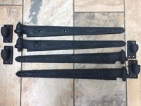 "Charles Collinge Lambeth - four antique, 24"" cast iron hinge straps with knuckles"