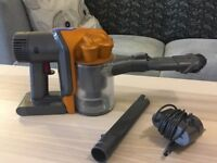 Dyson hand held vacuum cleaner model DC34