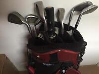 Golf clubs, bag and umbrella