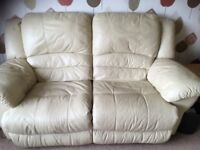 Two x two cream leather recliner sofas
