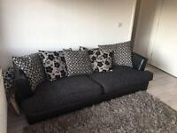 Charcoal grey/black 4 seater DFS sofa