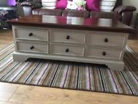 Sold wood table/ coffee table with 9 drawers each side