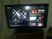 SAMSUNG HDMI 50 INCH TV Happy bartering. TV + firestick (all channels) and two designer stand table!