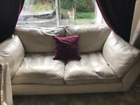 2 x 2 seater cream leather sofa for sale