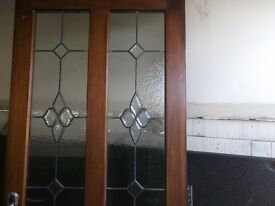 WOODEN DOOR WITH LEAD WINDOW PANELS