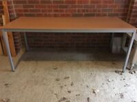 A nearly new large table - wood effect top, metal legs