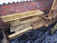 Pile of wood including pressure treated sleepers