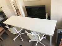 White desk with two office chairs