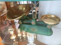 Vintage cast iron and brass scales with brass weights