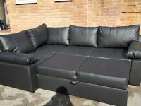 Fantastic Brand New black leather corner sofa bed with storage. can deliver