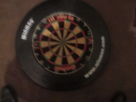1 WINMAU DARTBOARD PLUS A RUBBER PROTECTION RING