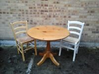 Small round pine dining table £30 and 2 chairs £10 each