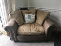 4 seater brown leather sofa & matching 2 seater love seat/chair. Well maintained, regularly cleaned.