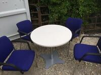 Round table and 4 stackable office chairs