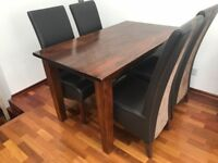 Beautiful hard wood dining table + 4 chairs - Excellent Conditons