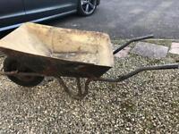 Metal wheelbarrow with inflatable tyre
