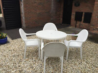 White plastic garden dining set for 4: table, chairs + cushions and table cloth