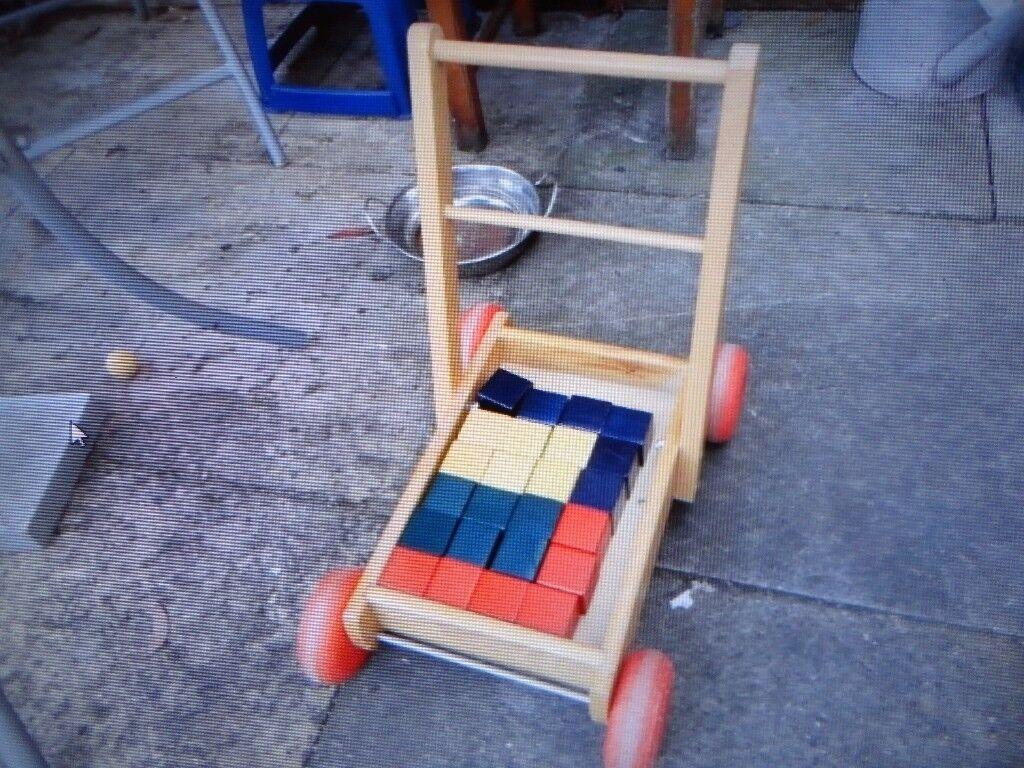 wooden baby walker and wooden blocks