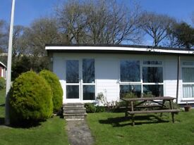 Homely, sunny 2 bed holiday bungalow with country and sea view