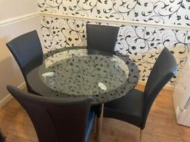 Glass table with 4 chairs and matching cabinet