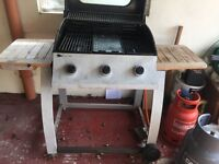 Gas BBQ with centre griddle.