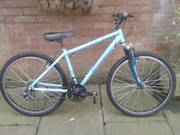 """Apollo xc26s mountain bike in turquoise, 21 gears , 26"""" wheels with good tred. Very Good condition."""