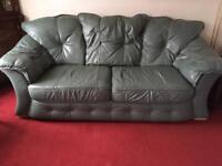 Green leather 3 seater sofa free